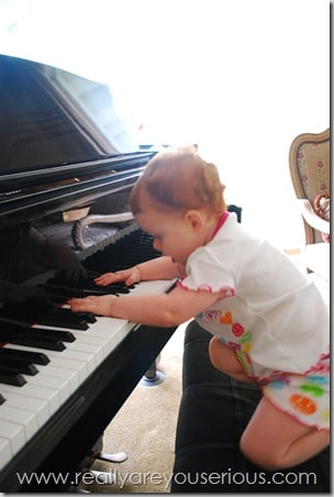 baby plays piano