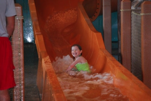 orange sliding with smiles.JPG