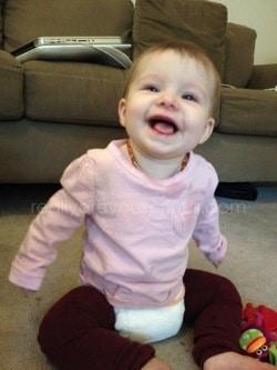 Happy girl in sbish cloth diaper