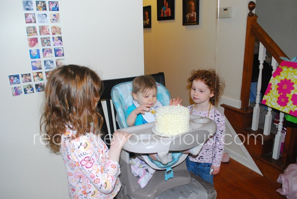 Sisters helping with the smash cake