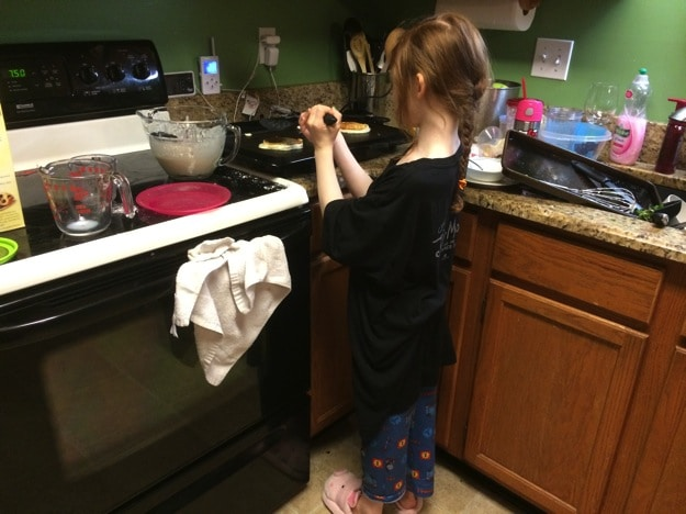 cooking herself breakfast