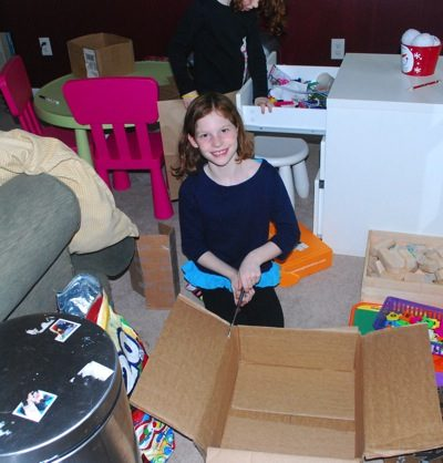 Using cardboard boxes to create dollhouses