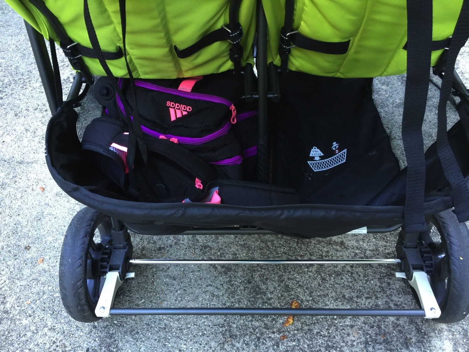 Giant backpack in basket of joovy scooter x2 with room to spare