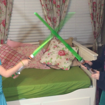 girls fighting with light sabers