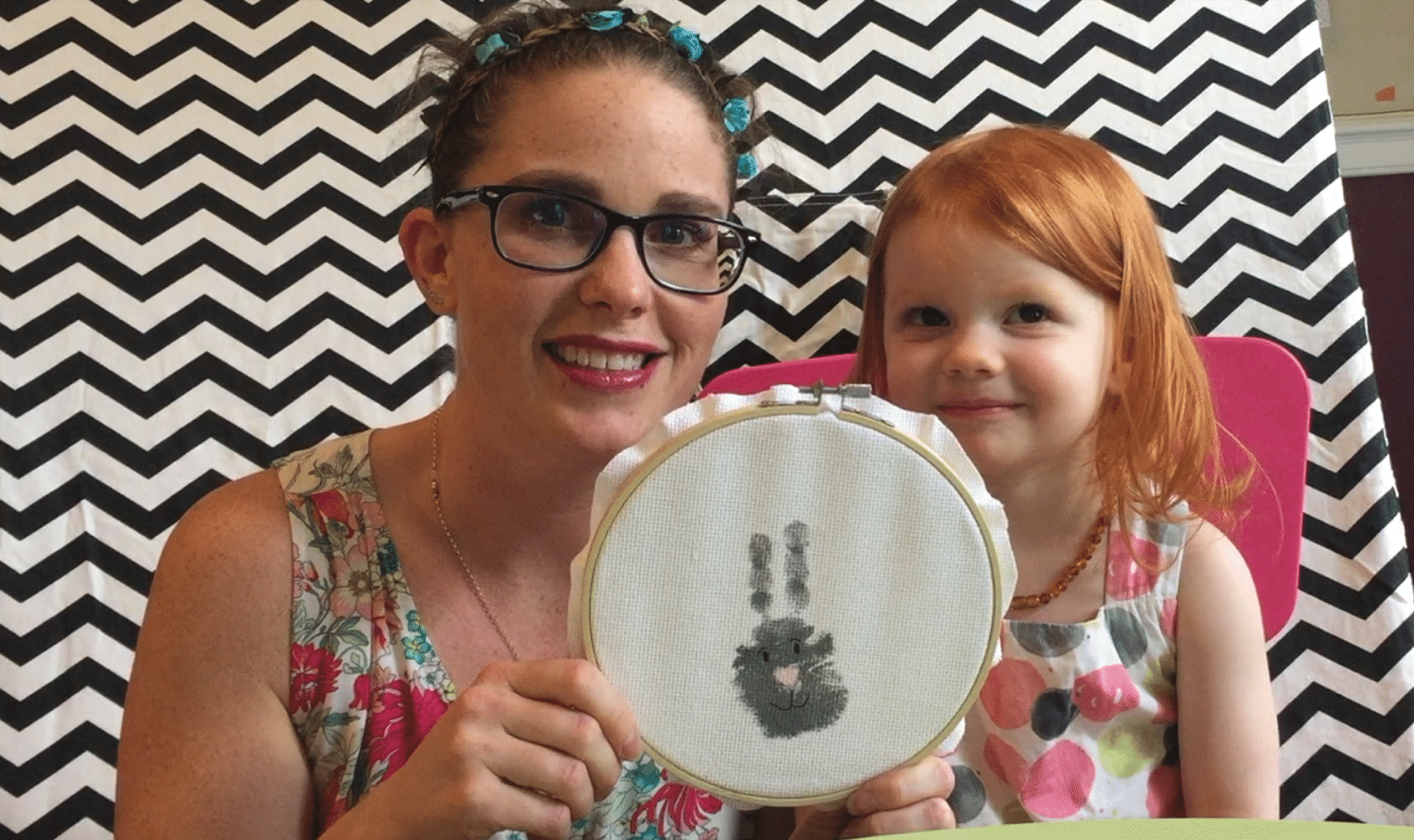 Handprint bunny craft in a loop frame
