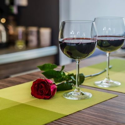 Date night in with two wine glasses and a rose