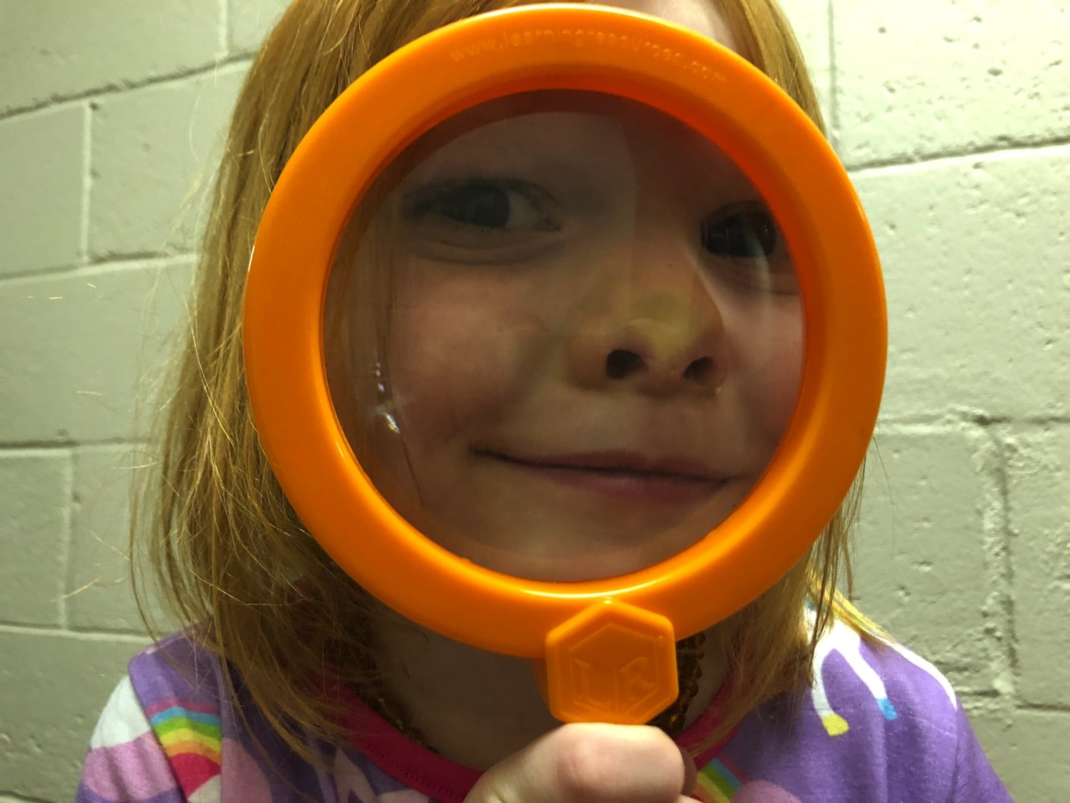 playing with magnifying glasses