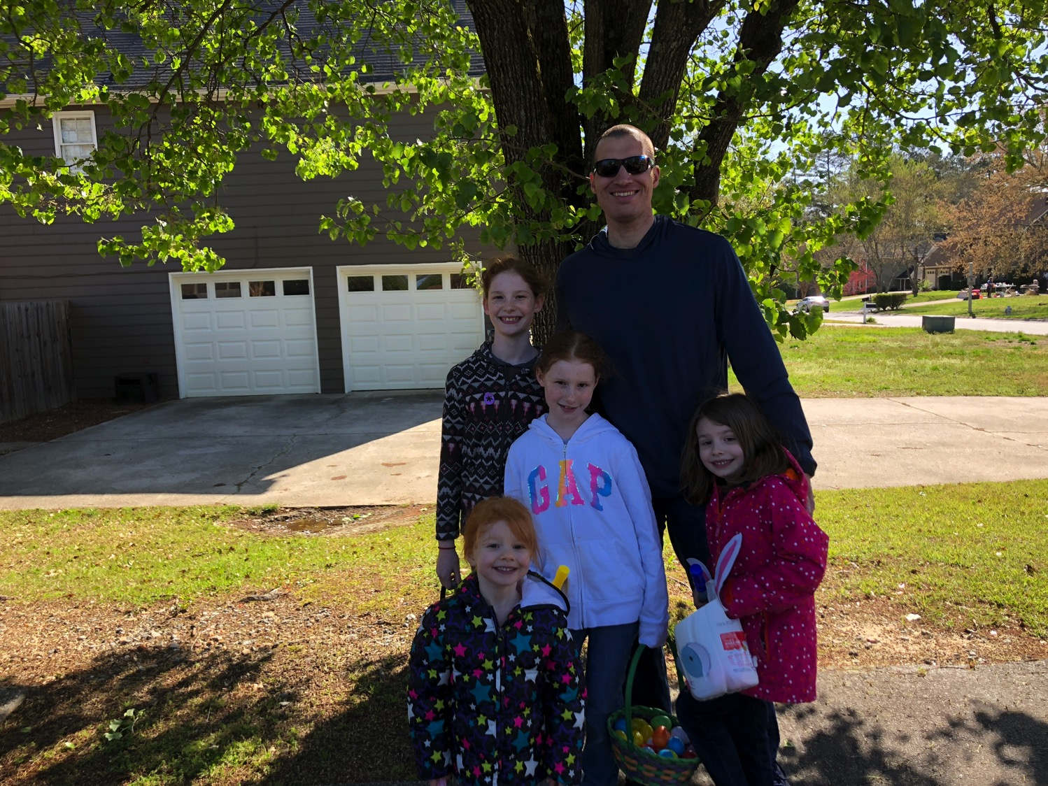 Daddy and the girls at easter egg hunt