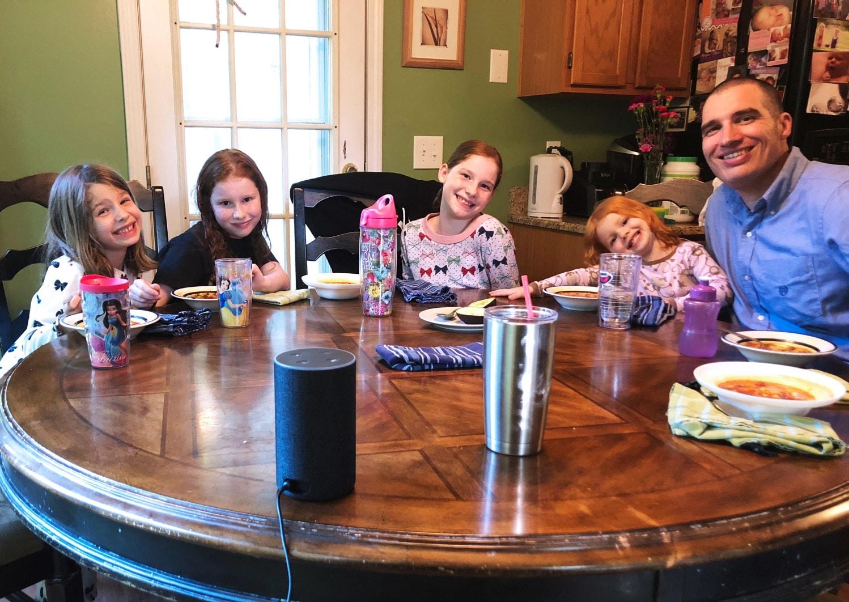 family around table amazon blueprint alexa trivia