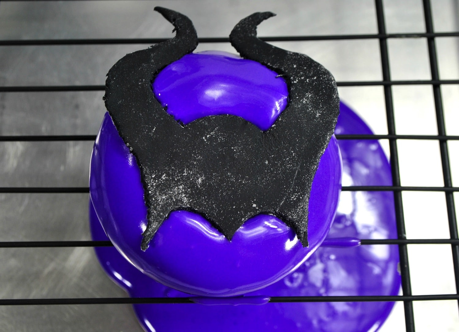 applying maleficent horns from fondant for Maleficent Donut