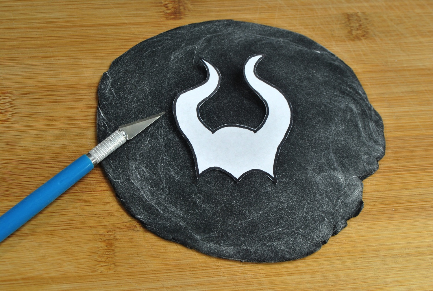 cutting out maleficent horns from fondant for Maleficent Donut