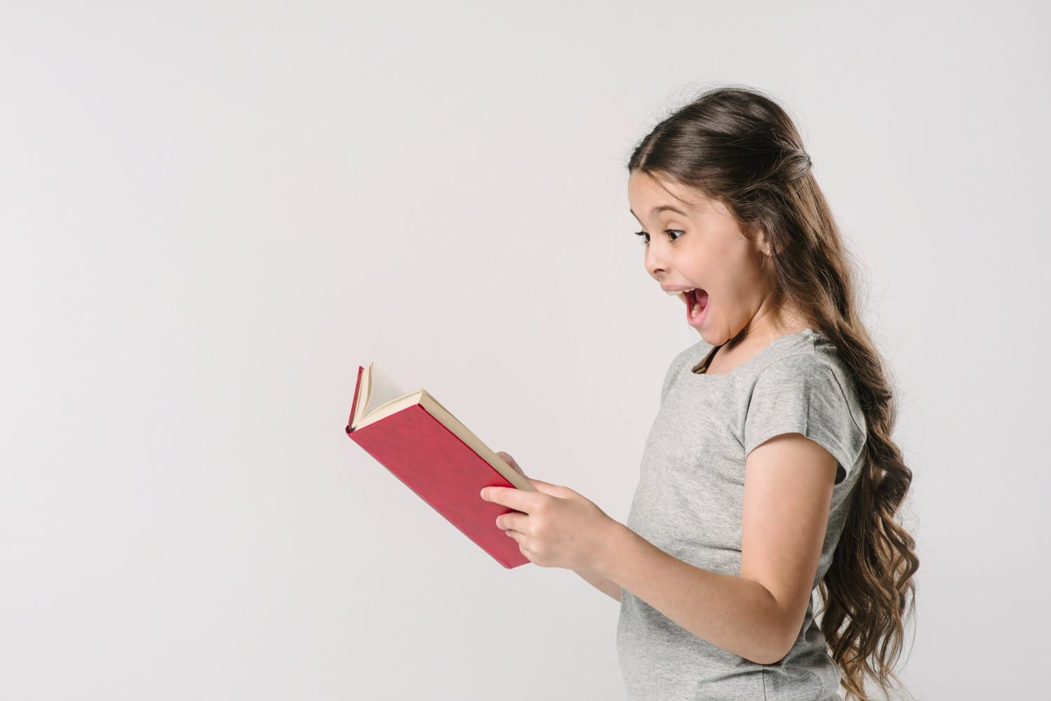 girl reading book excited