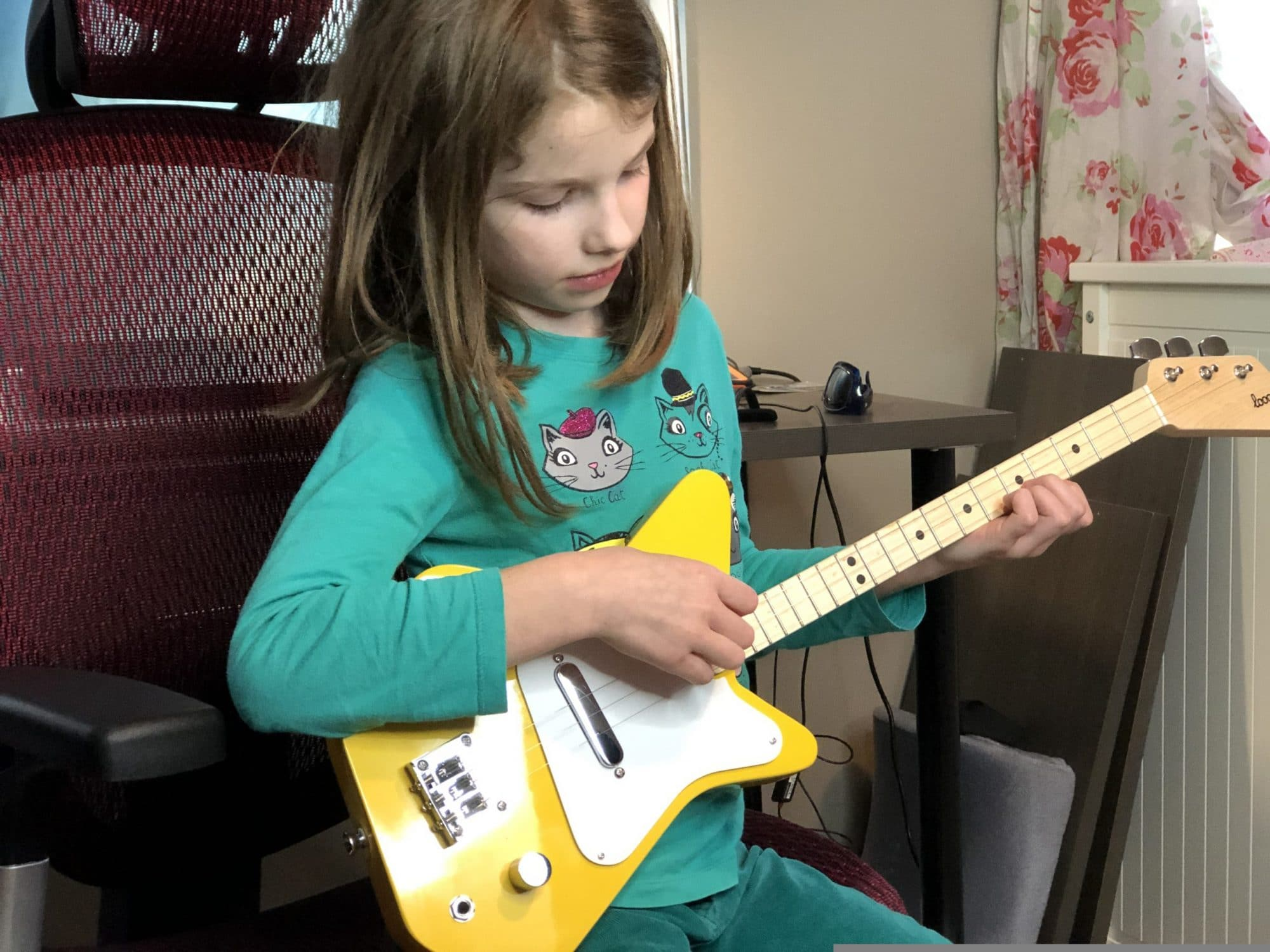 Loog guitar with kid for learning guitar