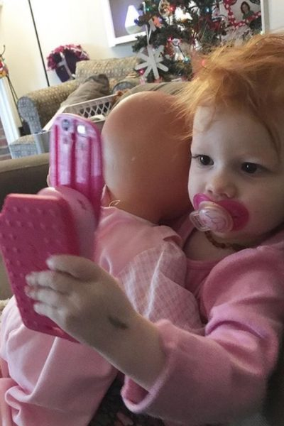 Baby playing with cell phones