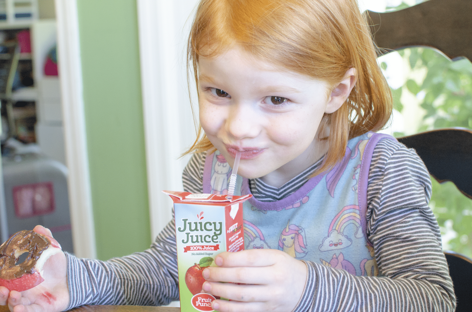 Happy with her juice and apple