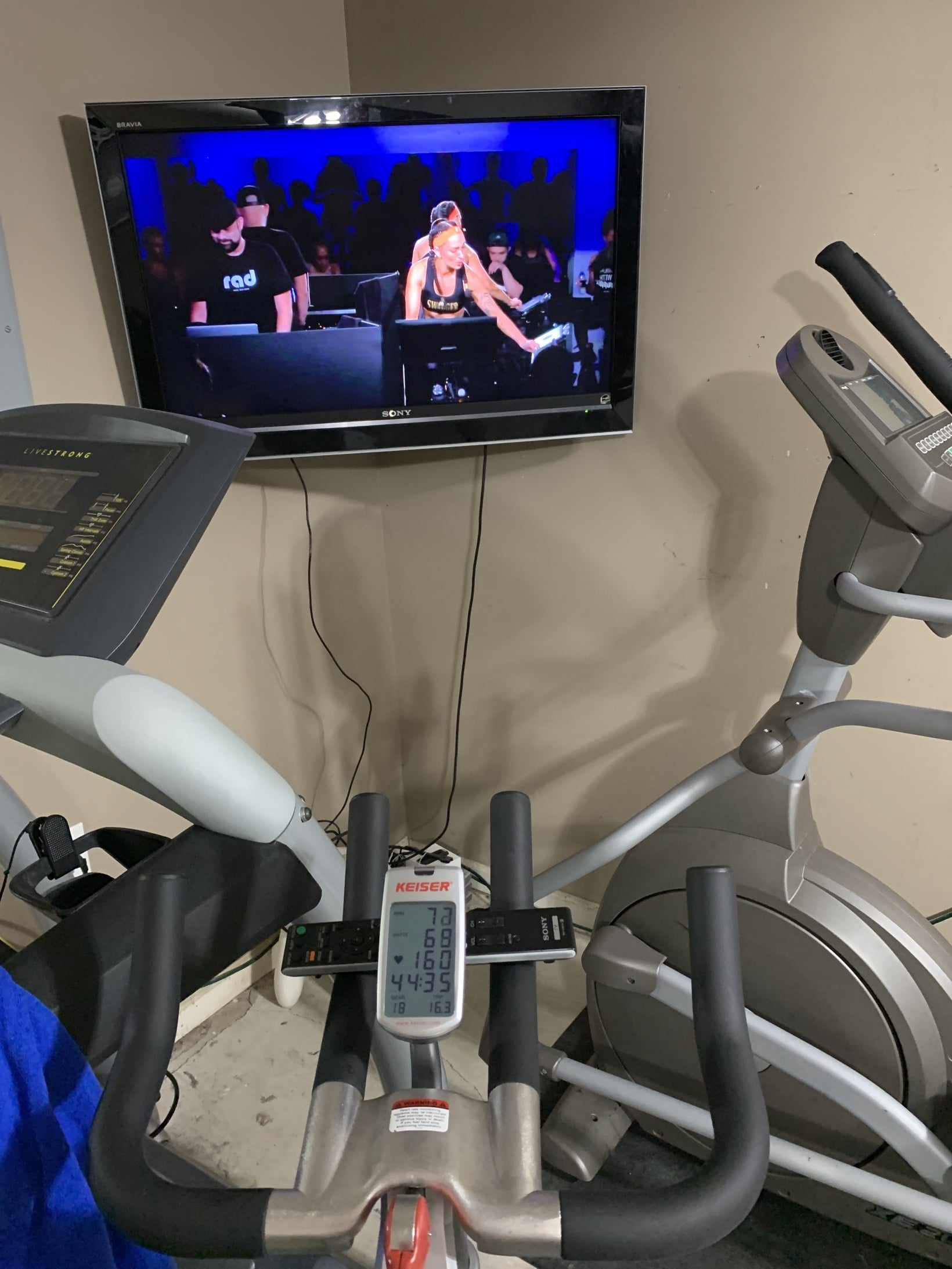 peloton set up with tv mounted in garage gym with puls
