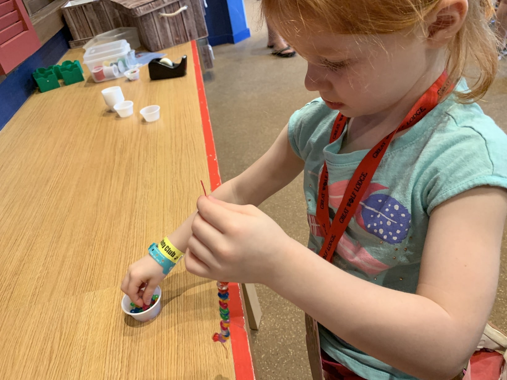 Great Wolf Lodge Summer Camp-In making beaded bracelet