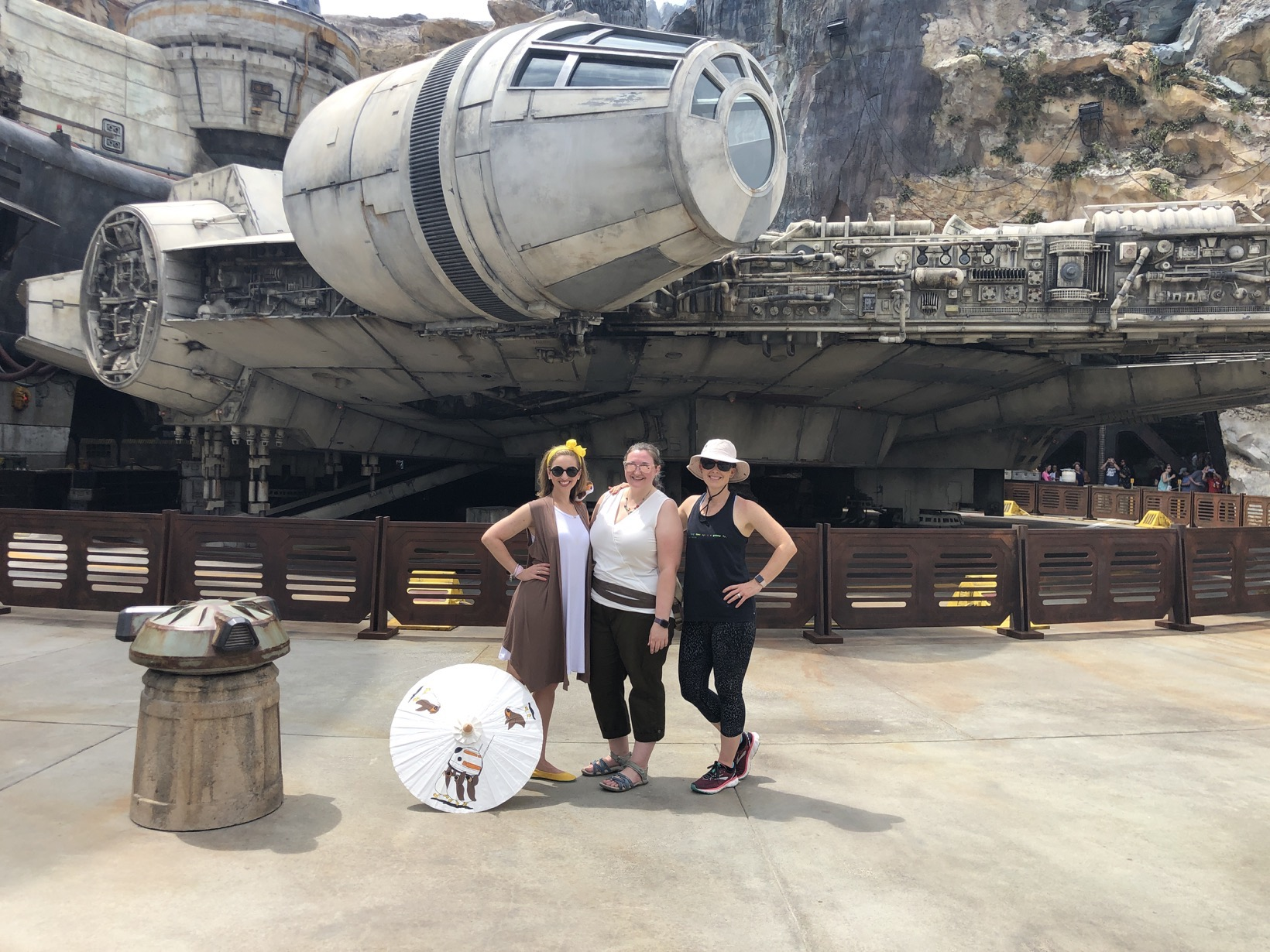 Star Wars Galaxy's Edge in front of Millenium Falcon