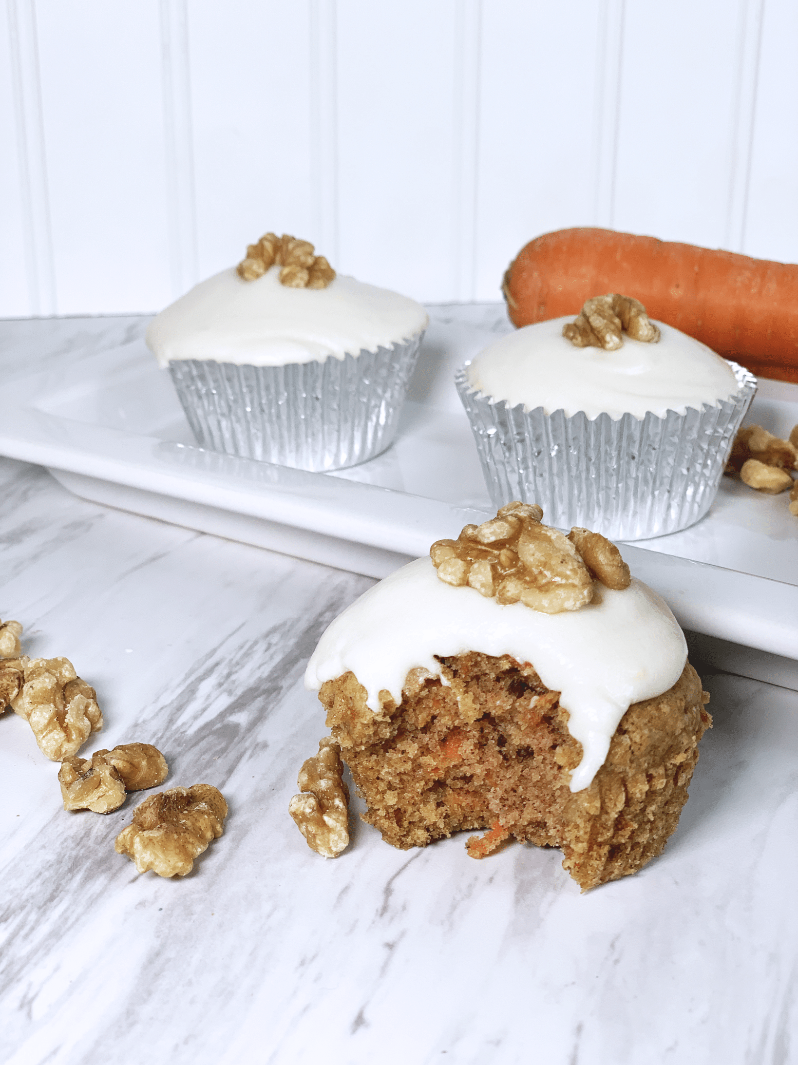 Dairy free cream cheese icing on gf df carrot cake cupcake