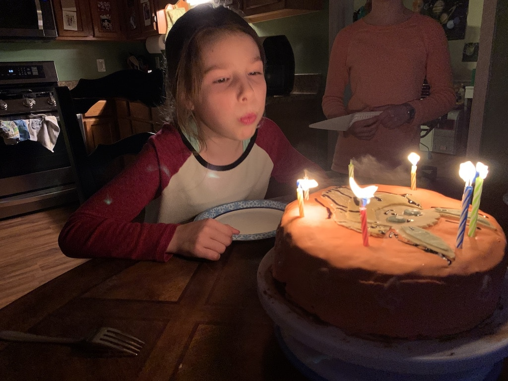 E blowing out candles