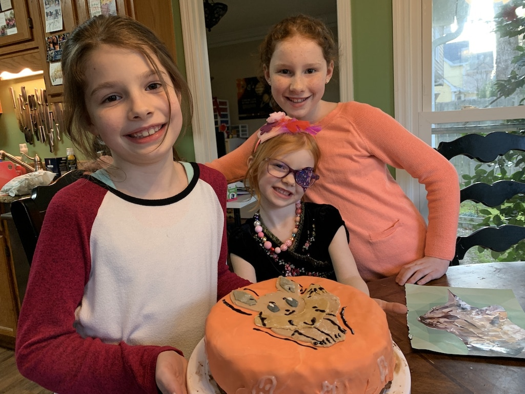 Girls with EEVEE pokemon birthday cake