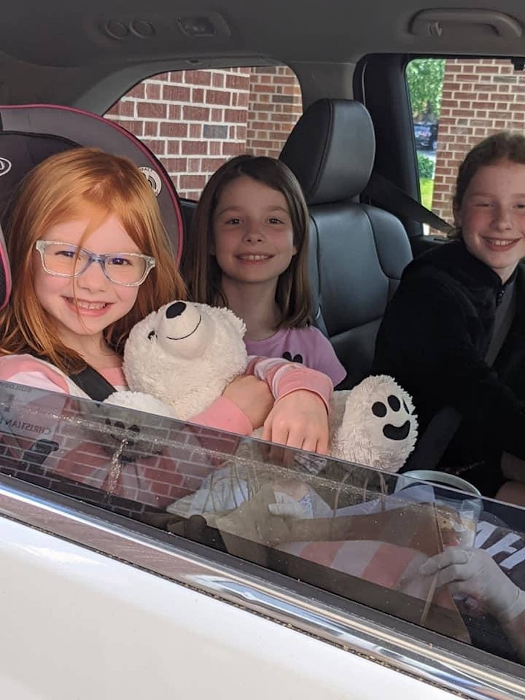 drive through car pick up with kids