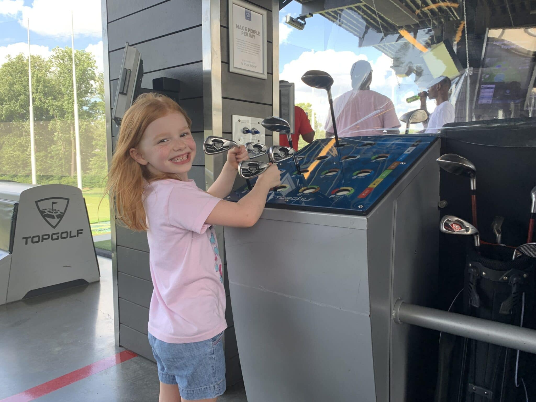 selecting a golf club at topgolf