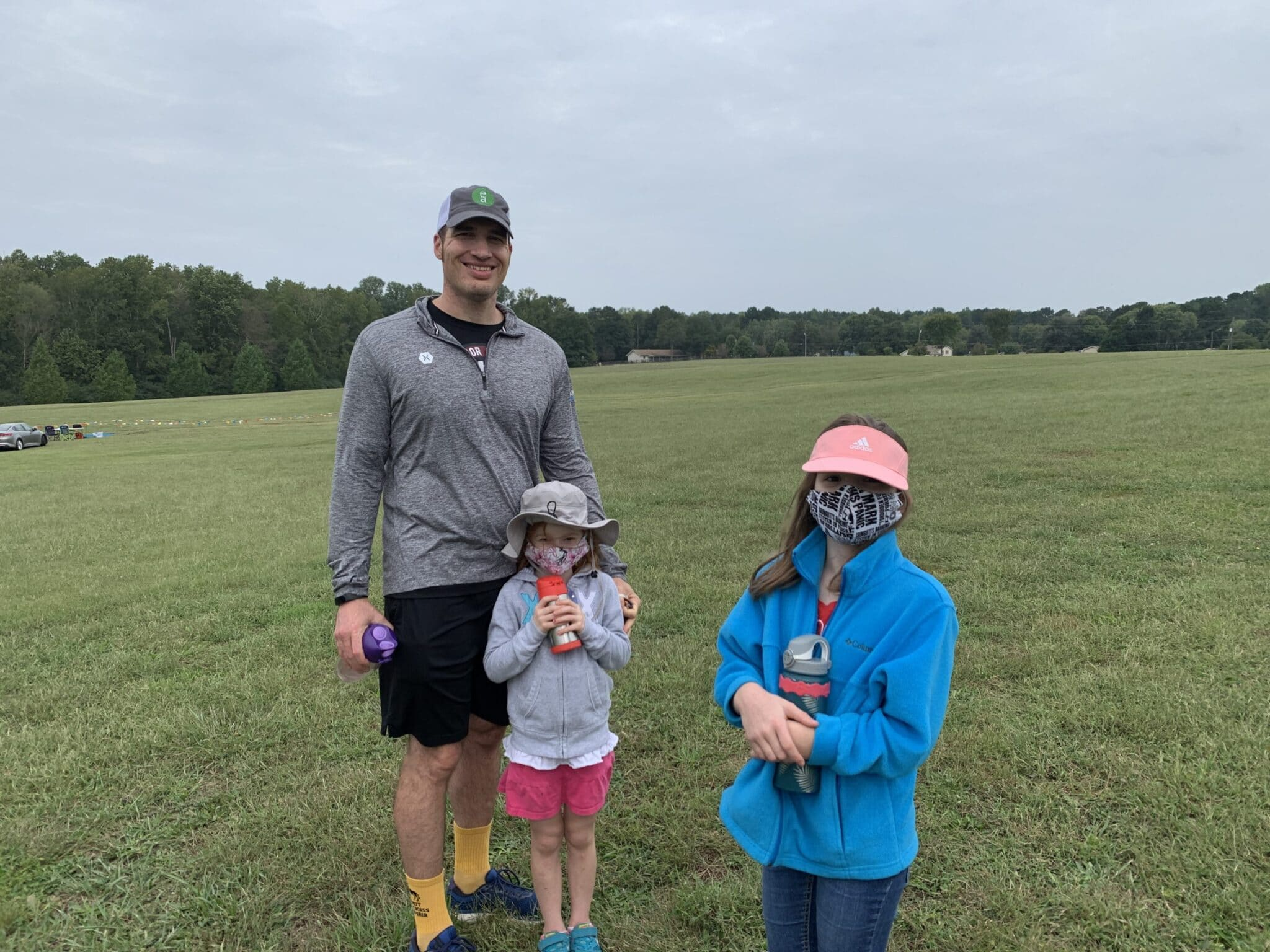 Daddy and girls at cross country meet