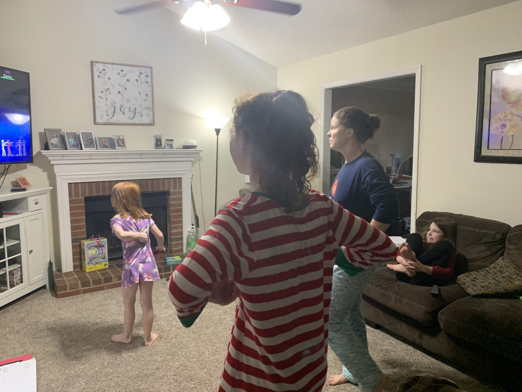 Family playing just dance 2021