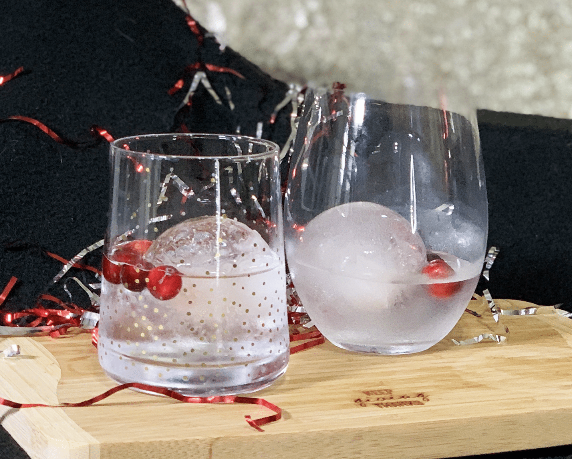 vodka soda with fresh cranberries and sphere ice mold