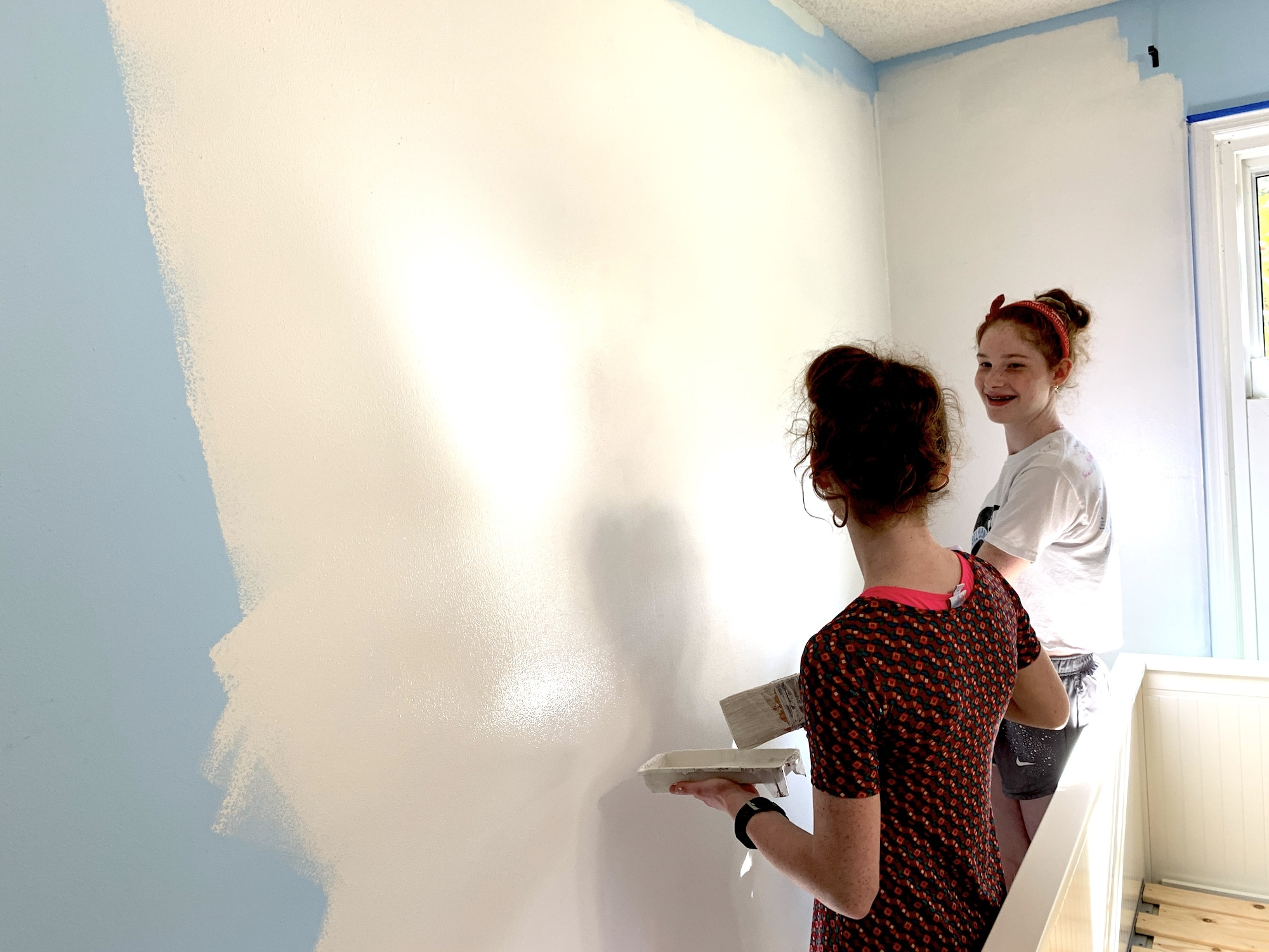 girls painting their room