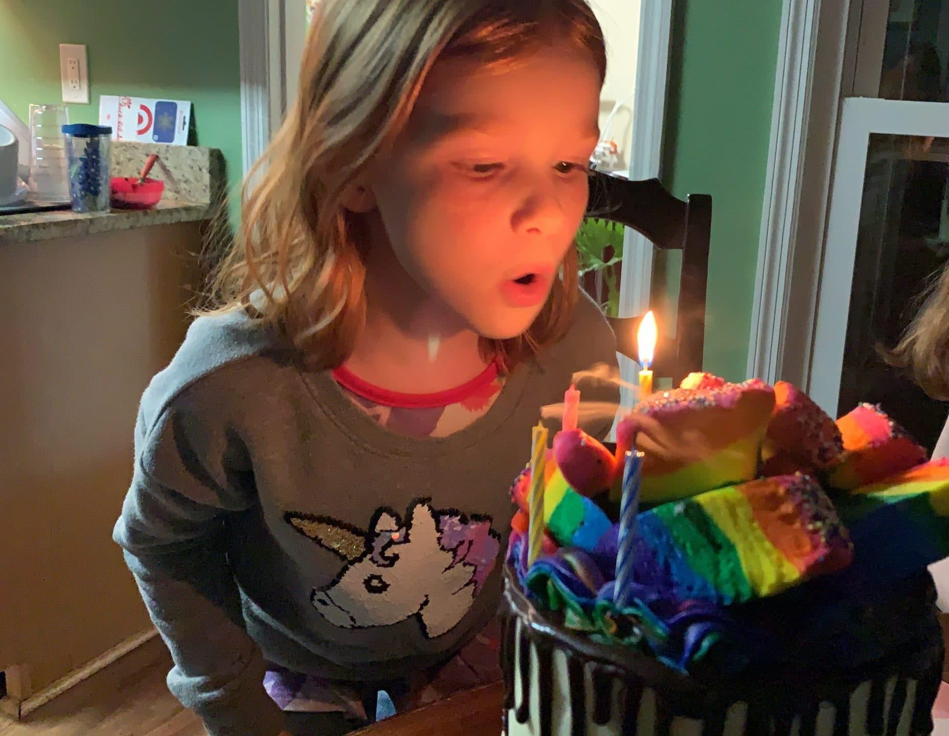 Happy 7th birthday B with candles and cake